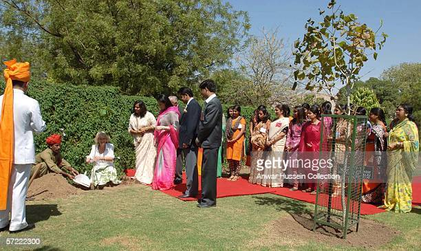 Camilla Duchess of Cornwall plants a tree next to one planted by the Prince of Wales in 2003 when she visits the Montessori Palace School in Jaipur...