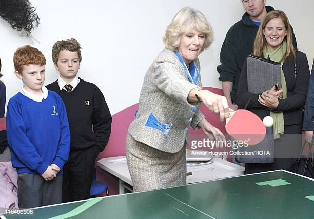 HRH Camilla Duchess Of Cornwall plays table tennis during her visit to Atworth Youth Club November 22 in her capacity as Patron of Youth Action...