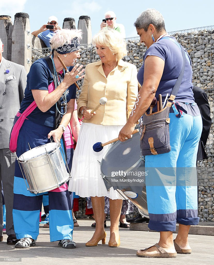 <a gi-track='captionPersonalityLinkClicked' href=/galleries/search?phrase=Camilla+-+Duchess+of+Cornwall&family=editorial&specificpeople=158157 ng-click='$event.stopPropagation()'>Camilla</a>, Duchess of Cornwall plays the drums as she and Prince Charles, Prince of Wales join a Samba band demonstration during a visit to the Whitstable Oyster Festival on July 29, 2013 in Whitstable, England.