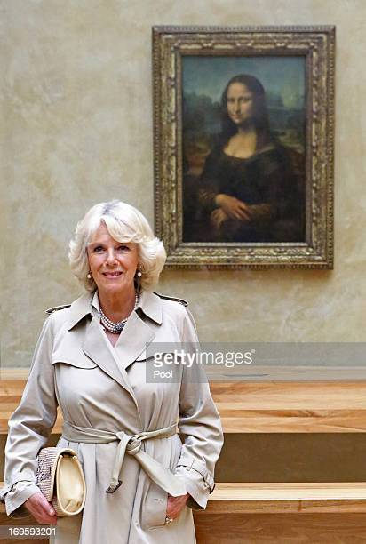 Camilla Duchess of Cornwall poses beside the Leonardo da Vinci's Mona Lisa painting as she visits the Louvre Museum on May 28 2013 in Paris France...