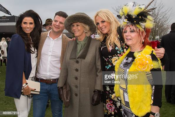 Camilla Duchess of Cornwall poses for a photograph in the paddock with racegoers including Katie Price on the second day of the Cheltenham Festival...