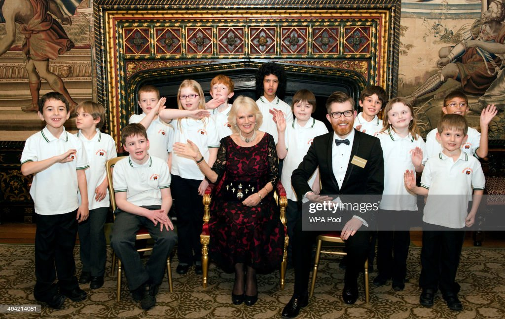 Camilla Duchess of Cornwall poses for a photograph with the Meath School Choir the 'Meath Singers' and Choir Master Gareth Malone during a Gala...
