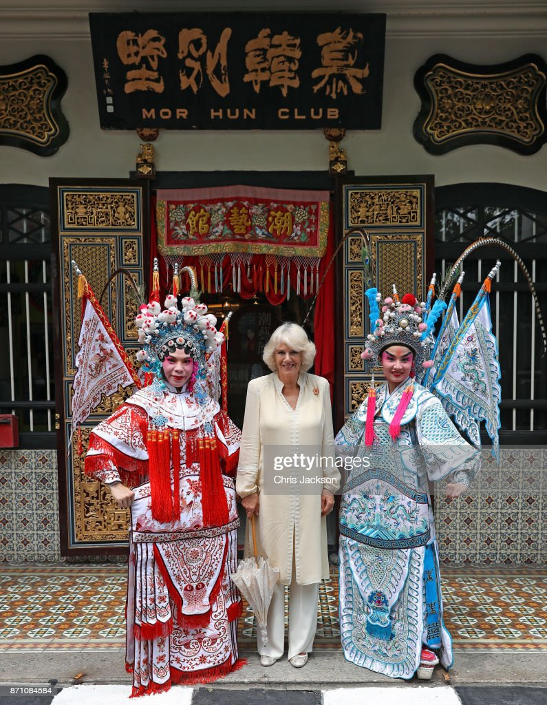 Camilla, Duchess of Cornwall poses with actresses at the Teochew Puppet & Opera House in George Town, Penang, Malaysia. Prince of Wales and Camilla, Duchess of Cornwall are on a tour of Singapore, Malaysia, Brunei and India.
