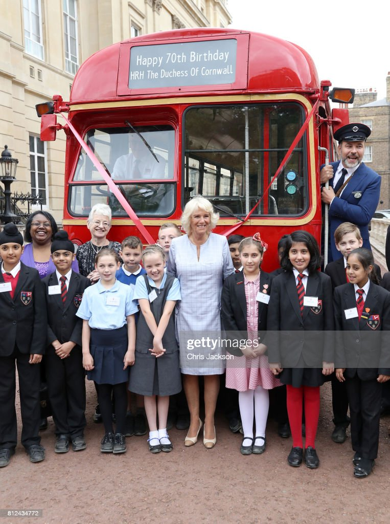 Camilla, Duchess of Cornwall (C) poses with author Jacqueline Wilson (second left), comedian and author David Walliams (R) dressed as an bus conductor, school children from Hemlington Hall Academy in Middlesbrough and Berkeley Primary School in Hounslow and guests during a tea party hosted by the Duchess of Cornwall to celebrate the Duchess's Bookshelves Project at Clarence House on July 11, 2017 in London, England. The Project is an initiative to find the nation's 70 favourite children's books to mark the Duchess of Cornwall's 70th birthday.