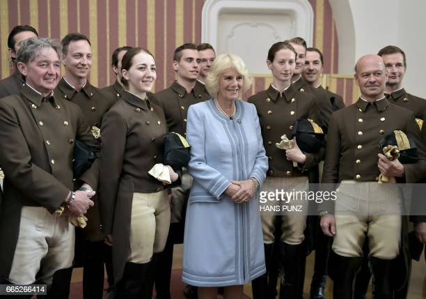 Camilla Duchess of Cornwall poses with the riders of the Spanish Riding School Elisabeth Guertler on April 6 in Vienna Austria PUNZ / Austria OUT