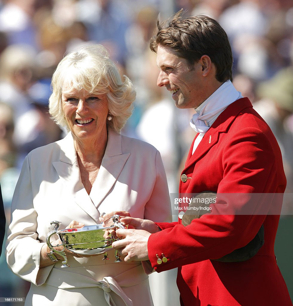 <a gi-track='captionPersonalityLinkClicked' href=/galleries/search?phrase=Camilla+-+Duchess+of+Cornwall&family=editorial&specificpeople=158157 ng-click='$event.stopPropagation()'>Camilla</a>, Duchess of Cornwall presents <a gi-track='captionPersonalityLinkClicked' href=/galleries/search?phrase=Harry+Meade&family=editorial&specificpeople=2264034 ng-click='$event.stopPropagation()'>Harry Meade</a> with a trophy during the prize giving ceremony at the Badminton Horse Trials on May 6, 2013 in Badminton, England.