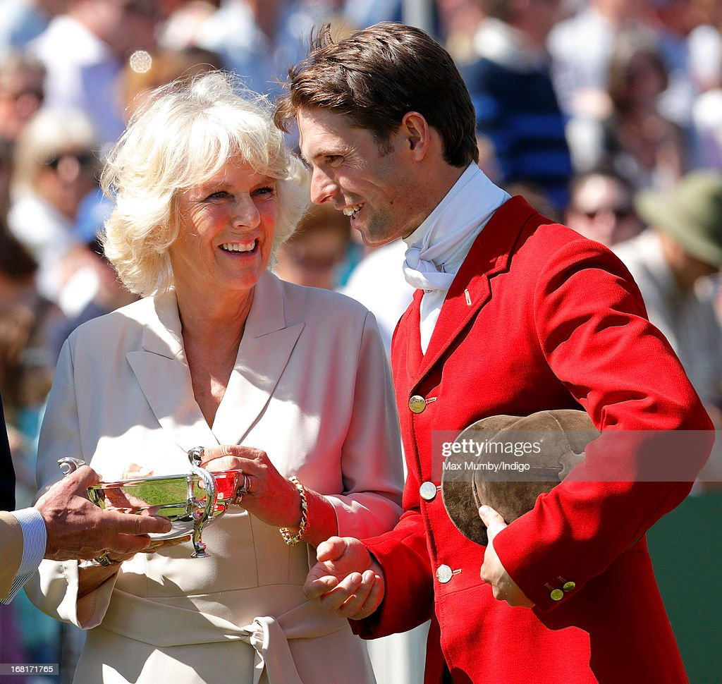 <a gi-track='captionPersonalityLinkClicked' href=/galleries/search?phrase=Camilla+-+Duchess+of+Cornwall&family=editorial&specificpeople=158157 ng-click='$event.stopPropagation()'>Camilla</a>, Duchess of Cornwall presents <a gi-track='captionPersonalityLinkClicked' href=/galleries/search?phrase=Harry+Meade+-+Equestrian&family=editorial&specificpeople=2264034 ng-click='$event.stopPropagation()'>Harry Meade</a> with a trophy during the prize giving ceremony at the Badminton Horse Trials on May 6, 2013 in Badminton, England.