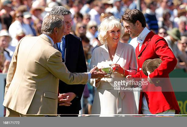 Camilla Duchess of Cornwall presents Harry Meade with a trophy during the prize giving ceremony at the Badminton Horse Trials on May 6 2013 in...