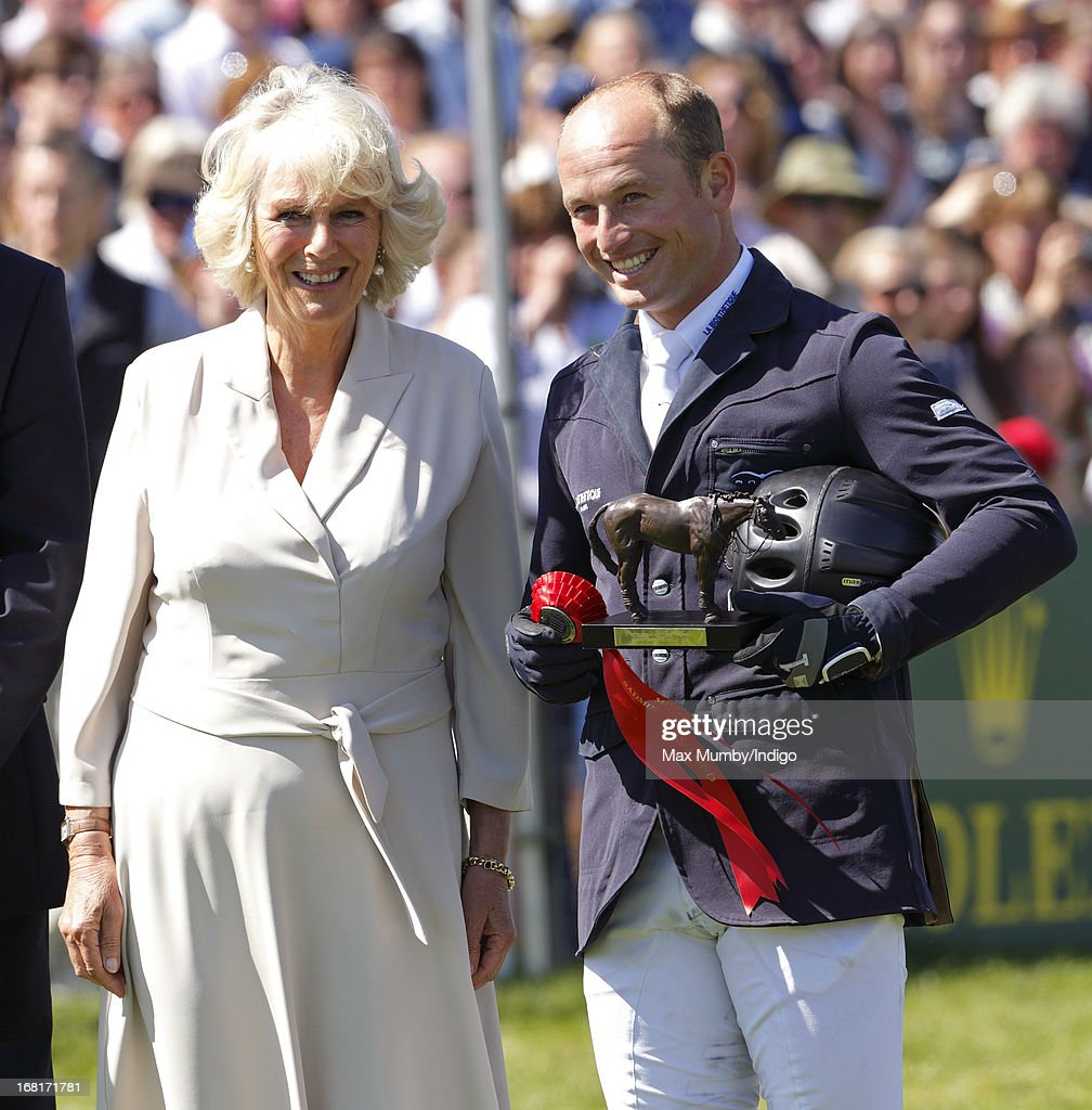 <a gi-track='captionPersonalityLinkClicked' href=/galleries/search?phrase=Camilla+-+Duchess+of+Cornwall&family=editorial&specificpeople=158157 ng-click='$event.stopPropagation()'>Camilla</a>, Duchess of Cornwall presents <a gi-track='captionPersonalityLinkClicked' href=/galleries/search?phrase=Michael+Jung+-+Equestrian&family=editorial&specificpeople=5533314 ng-click='$event.stopPropagation()'>Michael Jung</a> of Germany with the runner up trophy during the prize giving ceremony at the Badminton Horse Trials on May 6, 2013 in Badminton, England.