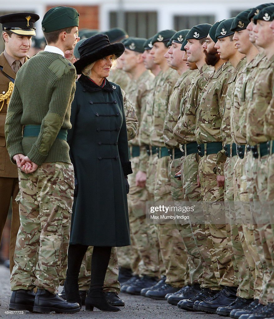 <a gi-track='captionPersonalityLinkClicked' href=/galleries/search?phrase=Camilla+-+Duchess+of+Cornwall&family=editorial&specificpeople=158157 ng-click='$event.stopPropagation()'>Camilla</a>, Duchess of Cornwall (in her role as Royal Colonel) presents Operational Service Medals to soldiers of 4th Battalion The Rifles on their return from Afghanistan at Ward Barracks, Bulford Camp on December 9, 2013 in Wiltshire, England.