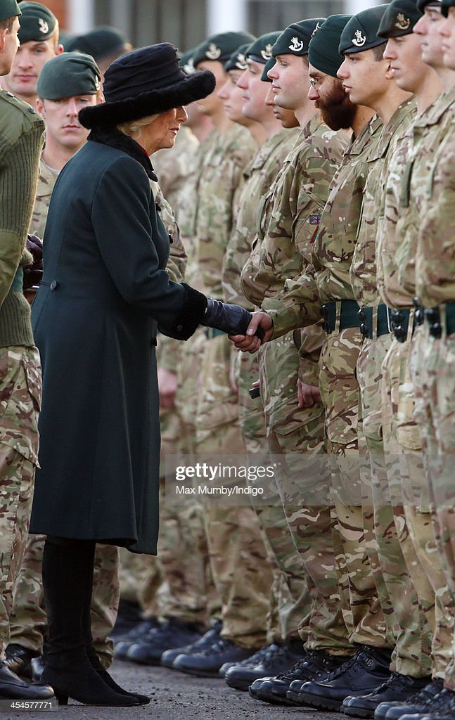 Camilla, Duchess of Cornwall (in her role as Royal Colonel) presents Operational Service Medals to soldiers of 4th Battalion The Rifles on their return from Afghanistan at Ward Barracks, Bulford Camp on December 9, 2013 in Wiltshire, England.