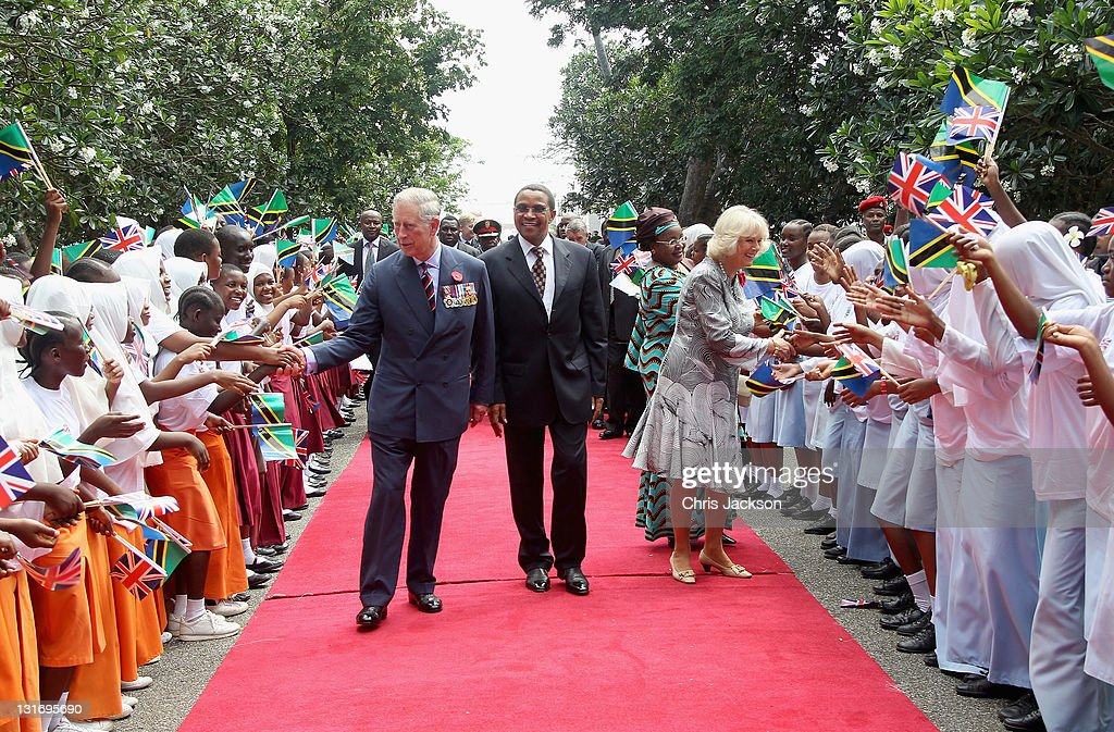 Camilla, Duchess of Cornwall, Prince Charles, Prince of Wales and President Jakaya Kikwete of Tanzania greet school children waving flags as they arrive at State House on November 7, 2011 in Dar Es Salaam, Tanzania. The Prince of Wales and the Duchess of Cornwall are on a four day tour of Tanzania after a successful trip to South Africa. The Royal couple will be highlighting environmental and social issues during their visit to Africa.