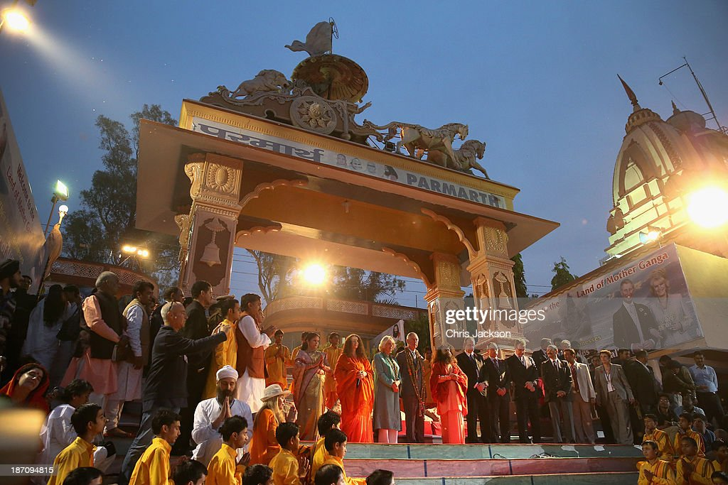 Camilla, Duchess of Cornwall, Prince Charles, Prince of Wales and Pujya Swami Chidanand Saraswatiji Maharaj take part in an Aarti ceremony at the Parmarth Niketan Temple on the banks of the River Ganges during day 1 of an official visit to India on November 6, 2013 in Dehradun, India. This will be the Royal couple's third official visit to India together and their most extensive yet, which will see them spending nine days in India and afterwards visiting Sri Lanka in order to attend the 2013 Commonwealth Heads of Government Meeting.