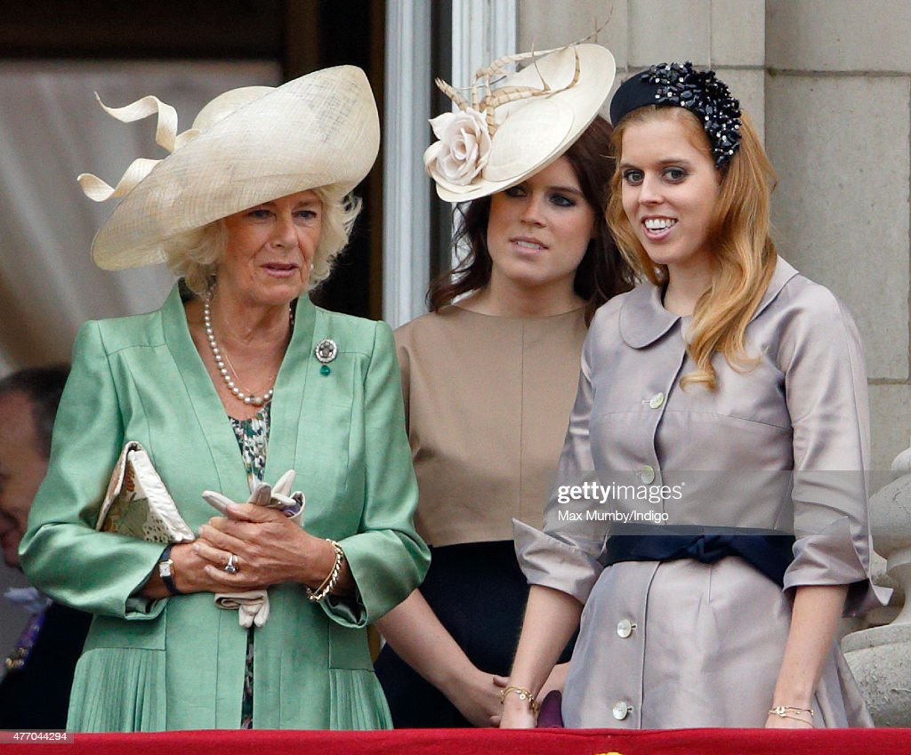 Camilla, Duchess of Cornwall, Princess Eugenie and Princess Beatrice stand on the balcony of Buckingham Palace during Trooping the Colour on June 13, 2015 in London, England. The ceremony is Queen Elizabeth II's annual birthday parade and dates back to the time of Charles II in the 17th Century, when the Colours of a regiment were used as a rallying point in battle.