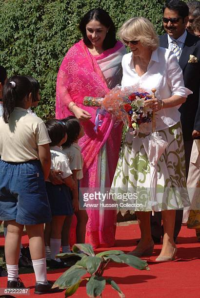 Camilla Duchess of Cornwall receives a bouquet of flowers at the Montessori Palace School in Jaipur on the final day of a 12 day official tour...