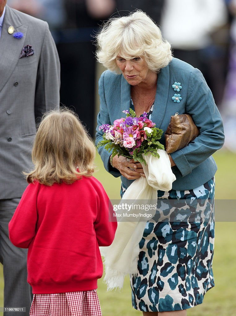 Camilla, Duchess of Cornwall receives a posy of flowers as she visits the 130th Sandringham Flower Show on July 27, 2011 in Huntingdon, England.