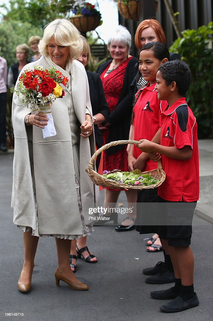 Camilla, Duchess of Cornwall recieves a bouquet of flowers during a visit to East Tamaki Primary School on November 12, 2012 in Auckland, New Zealand. The Royal couple are in New Zealand on the last leg of a Diamond Jubilee that takes in Papua New Guinea, Australia and New Zealand.