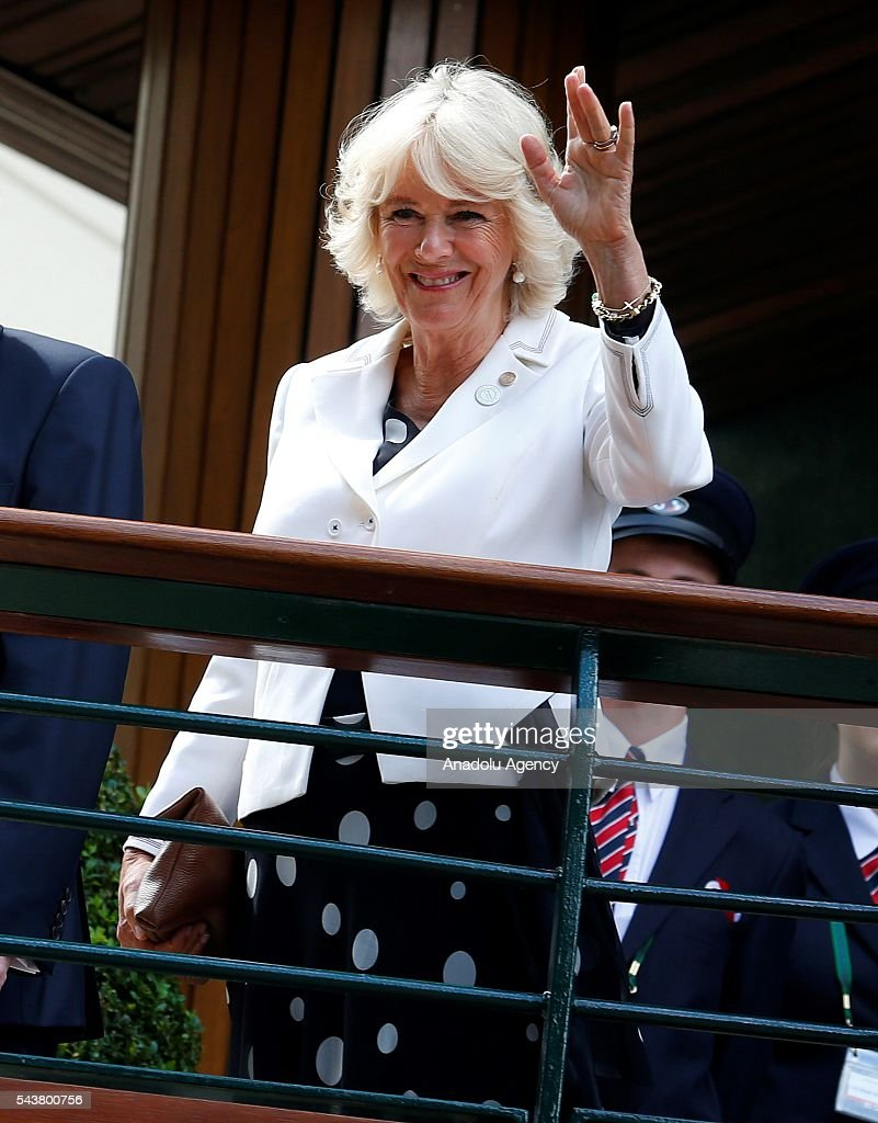 Camilla, Duchess of Cornwall salutes as she visits on day four of the 2016 Wimbledon Championships at the All England Lawn and Croquet Club in London, United Kingdom on June 30, 2016.