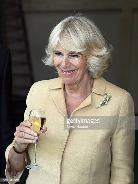 Camilla Duchess of Cornwall samples a glass of wine as she tours Ancre Hill vineyard on July 09 2015 in Monmouth Wales