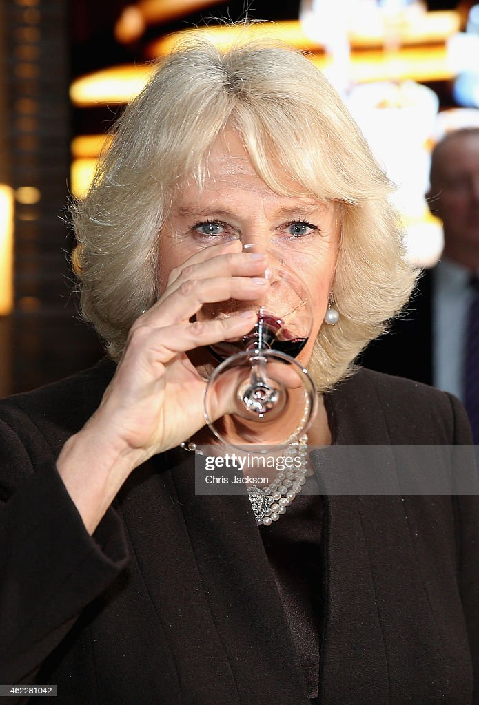 Camilla, Duchess of Cornwall samples Australian wines at an Australian Day Reception at The Violin Factory on January 26, 2015 in London, England. As well as Australian wines the Duchess was shown a cooking demonstration by Australian chef Lynton Tapp.