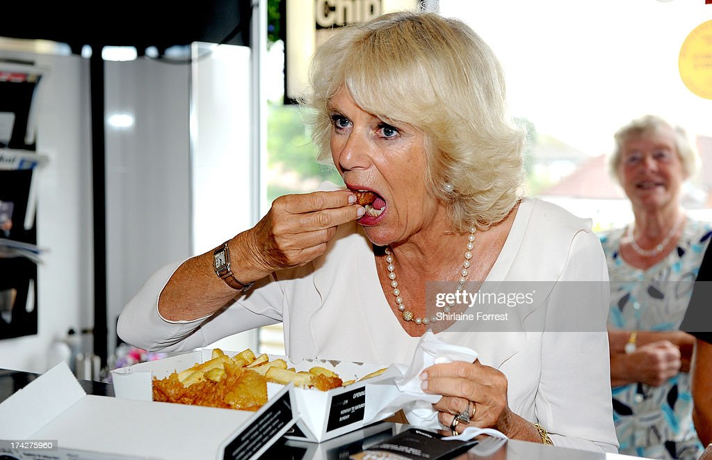 <a gi-track='captionPersonalityLinkClicked' href=/galleries/search?phrase=Camilla+-+Duchess+of+Cornwall&family=editorial&specificpeople=158157 ng-click='$event.stopPropagation()'>Camilla</a>, Duchess of Cornwall samples haddock and chips while visiting Fish and Chips at 149, on July 23, 2013 in Bridlington, England.