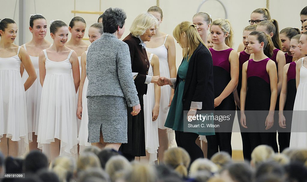 <a gi-track='captionPersonalityLinkClicked' href=/galleries/search?phrase=Camilla+-+Duchess+of+Cornwall&family=editorial&specificpeople=158157 ng-click='$event.stopPropagation()'>Camilla</a>, Duchess Of Cornwall shakes hands with girls as she visits St Catherine's School in Bramley, Surrey on February 13, 2014 in Guildford, England.