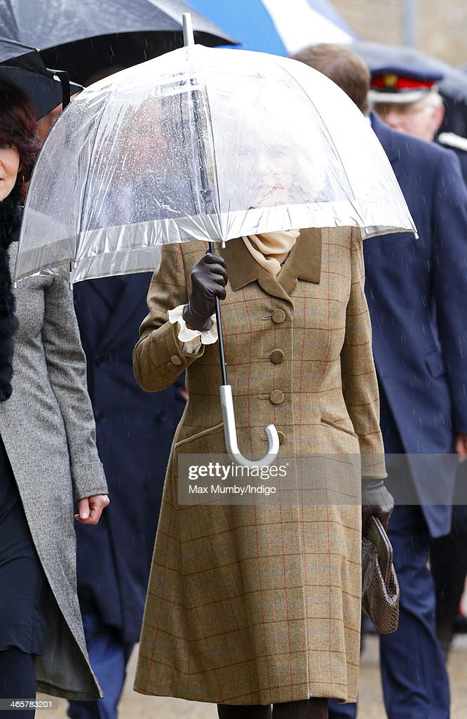 <a gi-track='captionPersonalityLinkClicked' href=/galleries/search?phrase=Camilla+-+Duchess+of+Cornwall&family=editorial&specificpeople=158157 ng-click='$event.stopPropagation()'>Camilla</a>, Duchess of Cornwall shelters under an umbrella as she and Prince Charles, Prince of Wales arrive for a visit to High House Production Park, The Royal Opera House's Production Workshop on a day of engagements in Essex on January 29, 2014 in Purfleet, England.