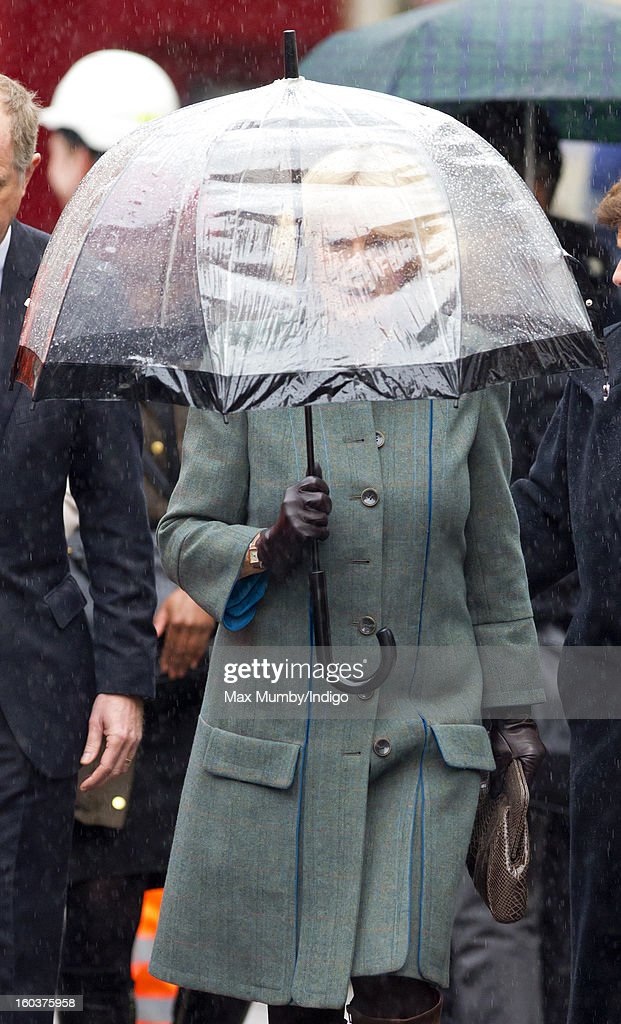 Camilla, Duchess of Cornwall shelters under an umbrella as she arrives at Farringdon Underground Station to view the nearby Crossrail development site before travelling on a Metropolitan line underground train to King's Cross on January 30, 2013 in London, England. The Prince of Wales and The Duchess of Cornwall are marking the 150th anniversary of London Underground to emphasise the importance of engineering and infrastructure development in the UK.