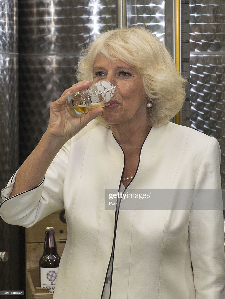 Camilla, Duchess of Cornwall sips sime Cider as she tours Cornish Orchards, a company which produces apple juice and cider, at Westnorth Manor Farm, Duloe on July 14, 2014 in Liskeard, England.
