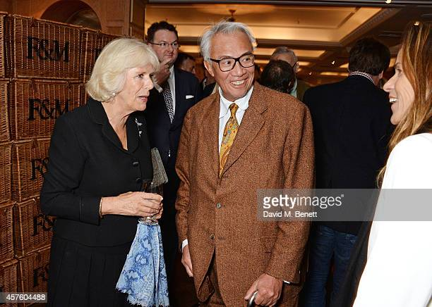 Camilla Duchess of Cornwall Sir David Tang and Lucy Tang attend Fortnum Mason's Diamond Jubilee Tea Salon for the launch of Tom Parker Bowles' new...