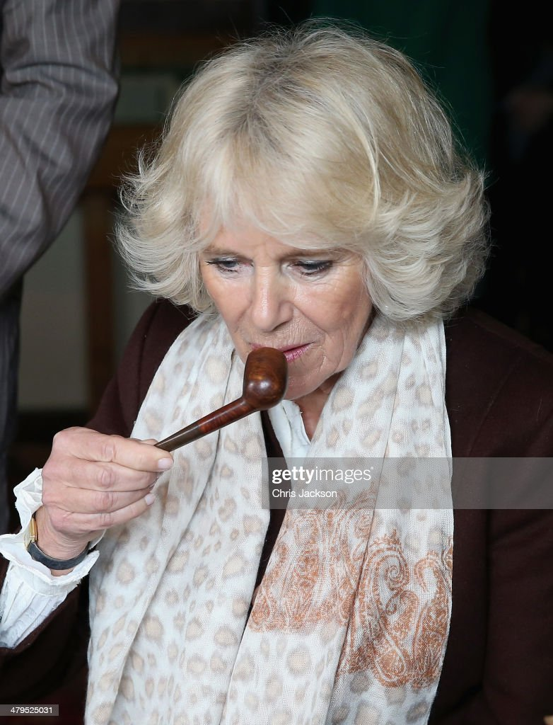 <a gi-track='captionPersonalityLinkClicked' href=/galleries/search?phrase=Camilla+-+Duchess+of+Cornwall&family=editorial&specificpeople=158157 ng-click='$event.stopPropagation()'>Camilla</a>, Duchess of Cornwall smells Rudyard Kipling's pipe as she sits at his desk during a visit to Bateman's, the East Sussex home of the author Rudyard Kipling, on March 19, 2014 in Burwash, United Kingdom. Bateman's was the secluded family home of the author, who wrote 'Jungle Book' and 'If'.