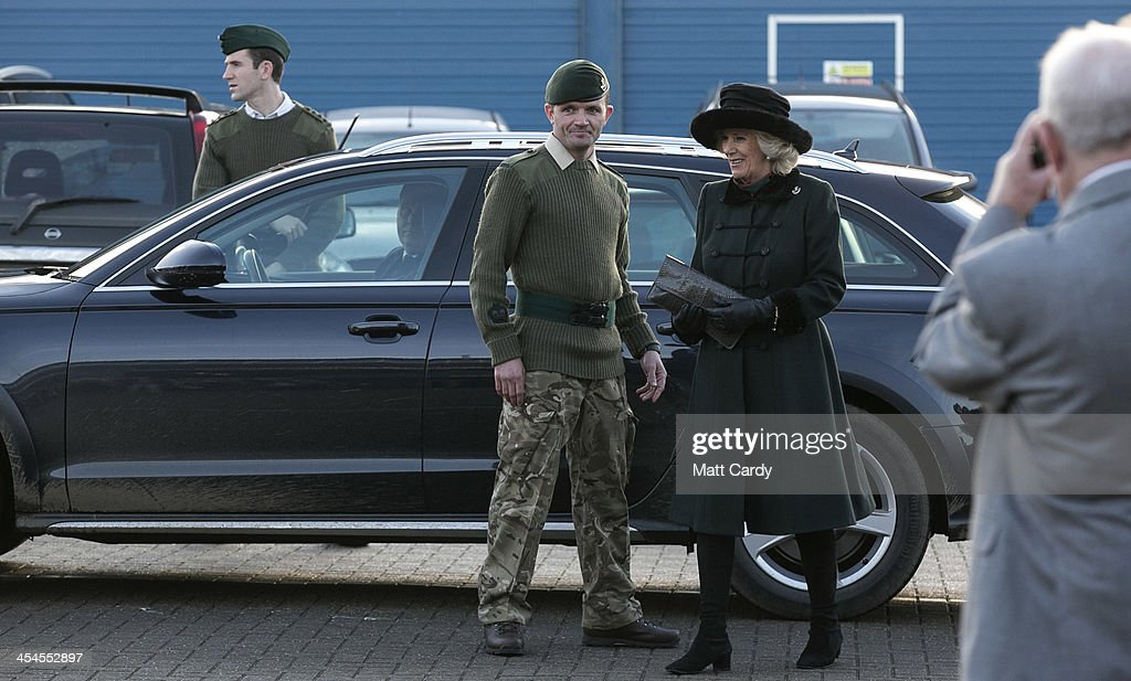 Camilla, Duchess of Cornwall smiles as she arrives to greet soldiers families as she welcomes home the 4th Battalion The Rifles and presents medals on their return from Afghanistan at their barracks in Bulford on December 9, 2013 in Wiltshire, England.