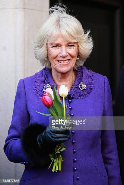 Camilla Duchess of Cornwall smiles as she holds flowers as she arrives at the Banski Dvori on the first day of a two day visit to Croatia on March 14...