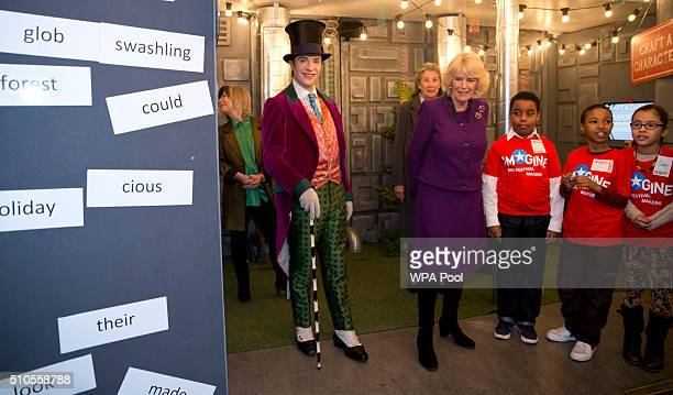 Camilla Duchess of Cornwall speaks to children attending the 'Imagine' festival as actor Jonothan Slinger as 'Willy Wonka' looks on during a preview...