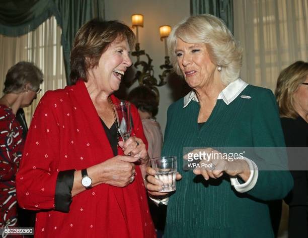 Camilla Duchess of Cornwall speaks to Dame Penelope Wilton during a reception to celebrate the launch of the 'Our Amazing People' campaign at...