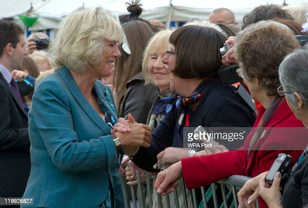 Camilla Duchess of Cornwall speaks to Elaine Ives during the 130th Sandringham Flower Show on July 27 2011 in Sandringham England