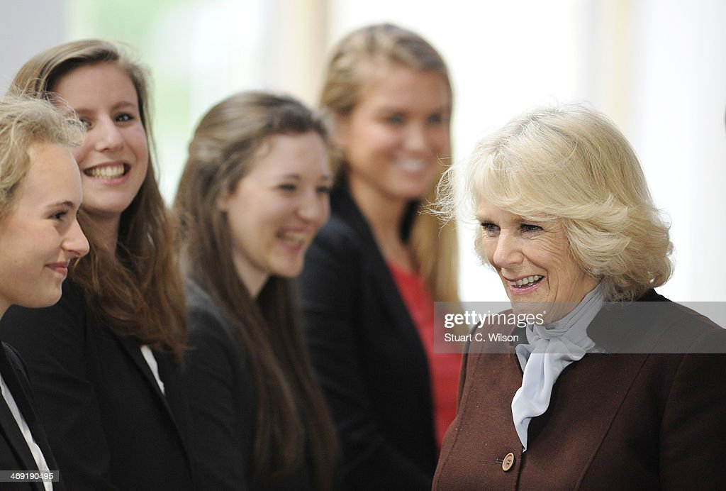 Camilla, Duchess Of Cornwall speaks to girls as she visits St Catherine's School in Bramley, Surrey on February 13, 2014 in Guildford, England.