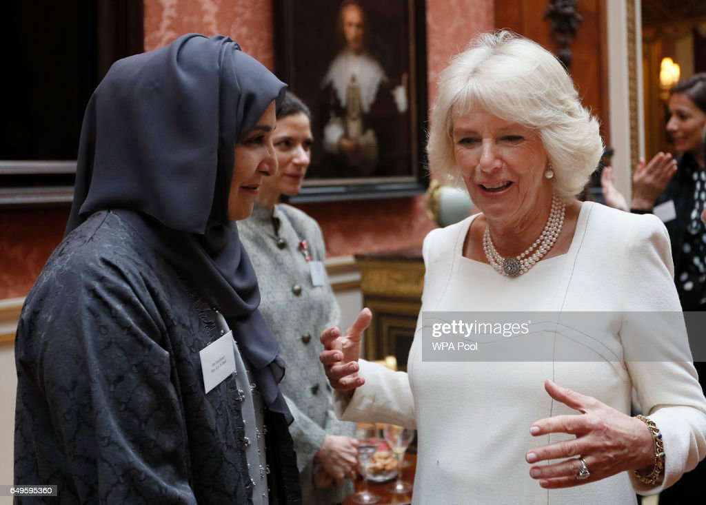 Camilla, Duchess of Cornwall speaks to Her Excellency Mrs Afra Al Basti as she hosts a Women of the World reception at Buckingham Palace on March 8, 2017 in London, England.