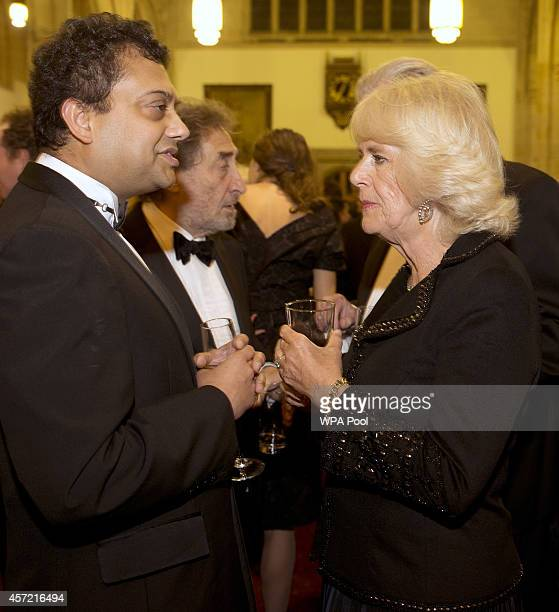 Camilla Duchess of Cornwall speaks to nominee British author Neel Mukherjee who wrote The Lives of Others' at the awards dinner for the Man Booker...