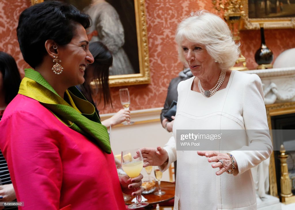 Camilla, Duchess of Cornwall speaks to Sandhini Poddar as she hosts a Women of the World reception at Buckingham Palace on March 8, 2017 in London, England.