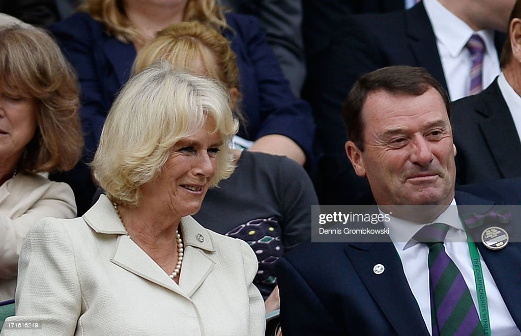 <a gi-track='captionPersonalityLinkClicked' href=/galleries/search?phrase=Camilla+-+Duchess+of+Cornwall&family=editorial&specificpeople=158157 ng-click='$event.stopPropagation()'>Camilla</a>, Duchess of Cornwall speaks with AELTC Chairman Philip Brook before the Gentlemen's Singles second round match between Jesse Levine of Canada and Juan Martin Del Potro of Argentina on Centre Court during day four of the Wimbledon Lawn Tennis Championships at the All England Lawn Tennis and Croquet Club on June 27, 2013 in London, England.