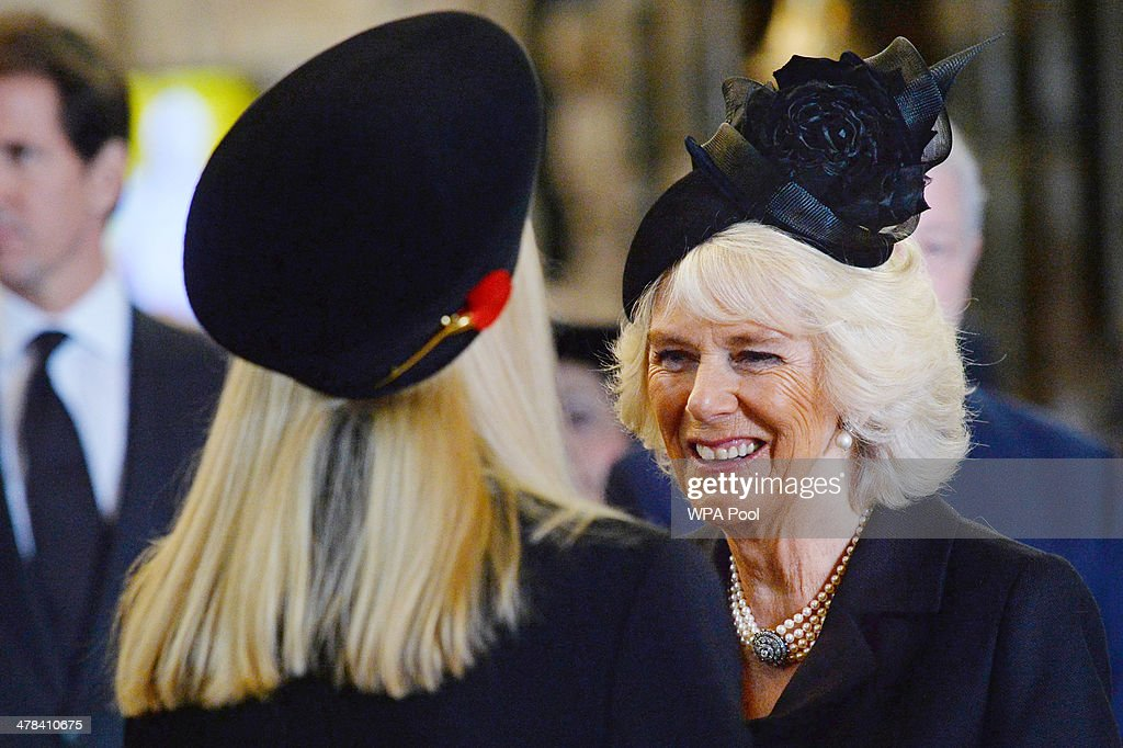 Camilla Duchess of Cornwall speaks with Carina Frost widow of British broadcaster David Frost following a memorial service for David Frost at...