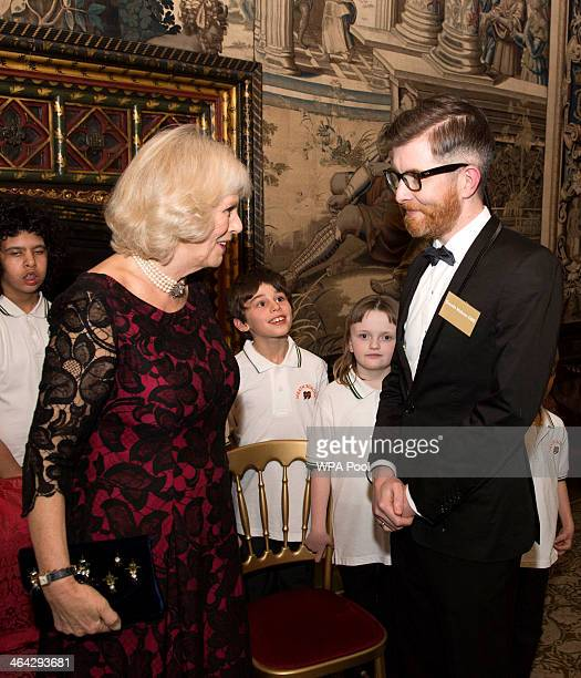 Camilla Duchess of Cornwall speaks with Choir Master Gareth Malone during a Gala Concert and Reception to mark the 125th Anniversary of I CAN and...