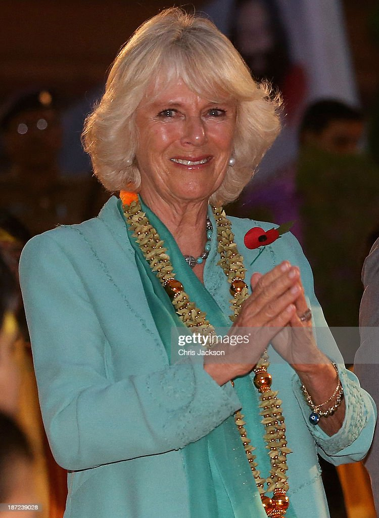 <a gi-track='captionPersonalityLinkClicked' href=/galleries/search?phrase=Camilla+-+Duchess+of+Cornwall&family=editorial&specificpeople=158157 ng-click='$event.stopPropagation()'>Camilla</a>, Duchess of Cornwall takes part in an Aarti ceremony at the Parmarth Niketan Temple on the banks of the River Ganges during day 1 of an official visit to India on November 6, 2013 in Dehradun, India. This will be the Royal couple's third official visit to India together and their most extensive yet, which will see them spending nine days in India and afterwards visiting Sri Lanka in order to attend the 2013 Commonwealth Heads of Government Meeting.