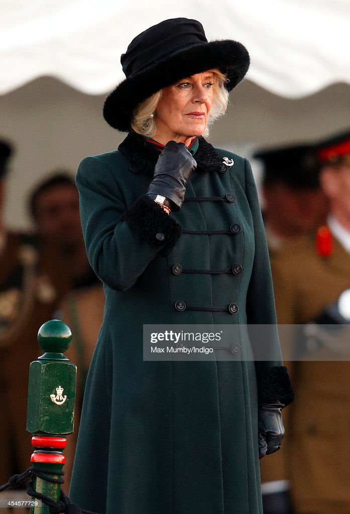 Camilla, Duchess of Cornwall (in her role as Royal Colonel) takes the salute after presenting Operational Service Medals to soldiers of 4th Battalion The Rifles on their return from Afghanistan at Ward Barracks, Bulford Camp on December 9, 2013 in Wiltshire, England.