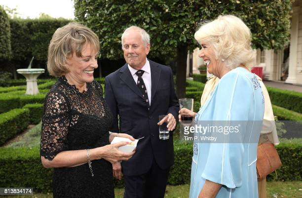 Camilla Duchess of Cornwall talking to Esther Rantzen and Gyles Brandreth at a reception to mark her 70th birthday at Clarence House on July 13 2017...