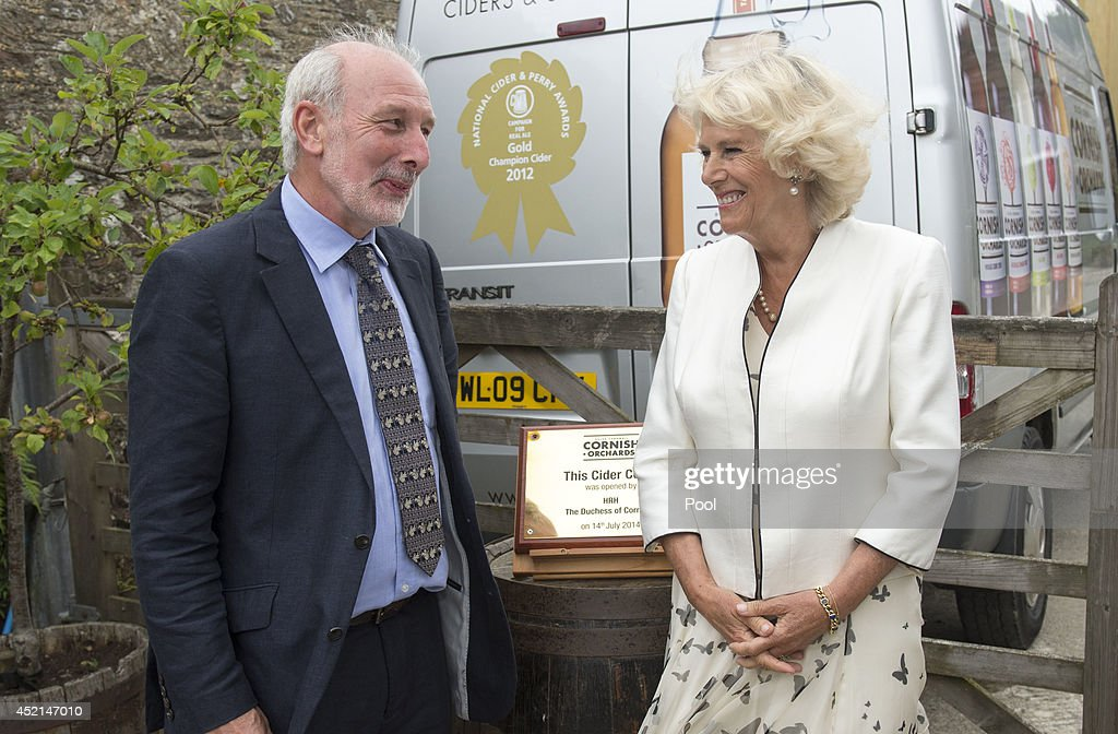 <a gi-track='captionPersonalityLinkClicked' href=/galleries/search?phrase=Camilla+-+Duchess+of+Cornwall&family=editorial&specificpeople=158157 ng-click='$event.stopPropagation()'>Camilla</a>, Duchess of Cornwall talks to Managing Director and founder Andy Atkinson of Cornish Orchards, a company which produces apple juice and cider, at Westnorth Manor Farm, Duloe on July 14, 2014 in Liskeard, England.