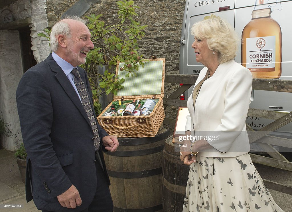 Camilla, Duchess of Cornwall talks to Managing Director and founder Andy Atkinson of Cornish Orchards, a company which produces apple juice and cider, at Westnorth Manor Farm, Duloe on July 14, 2014 in Liskeard, England.