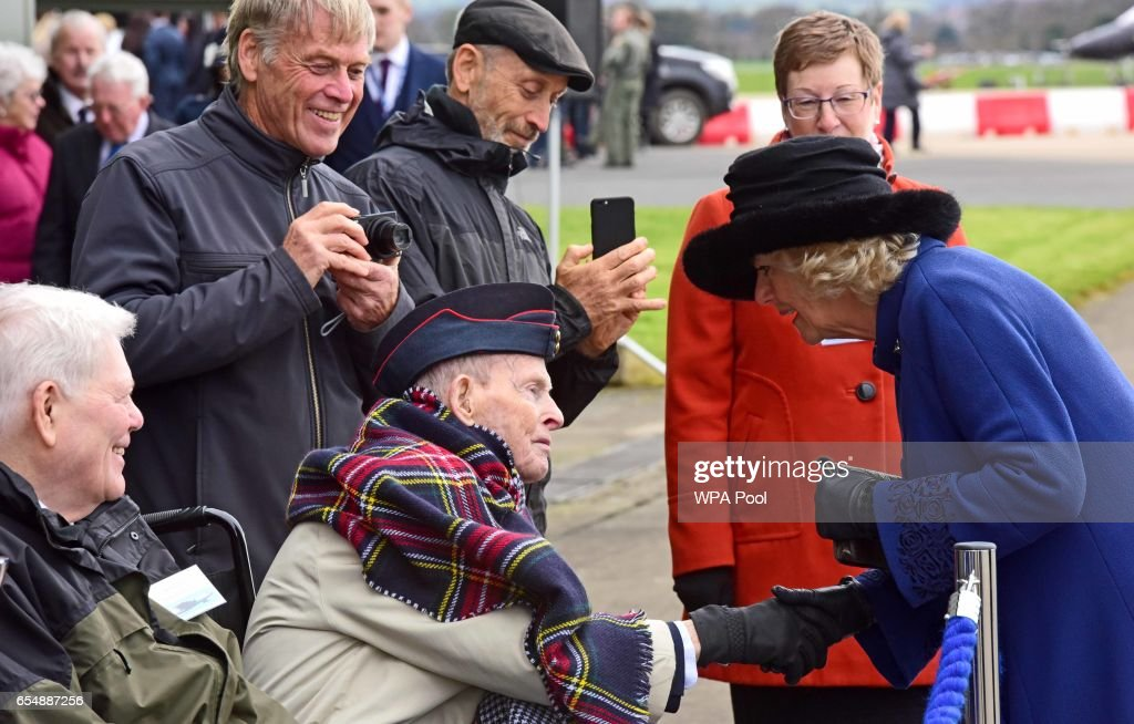 Camilla, Duchess of Cornwall talks to veteran Bob Petersen, 92, during a visit to RAF Leeming for the 100 Squadron Centenary on March 18, 2017 in Gatenby, Northallerton, England.