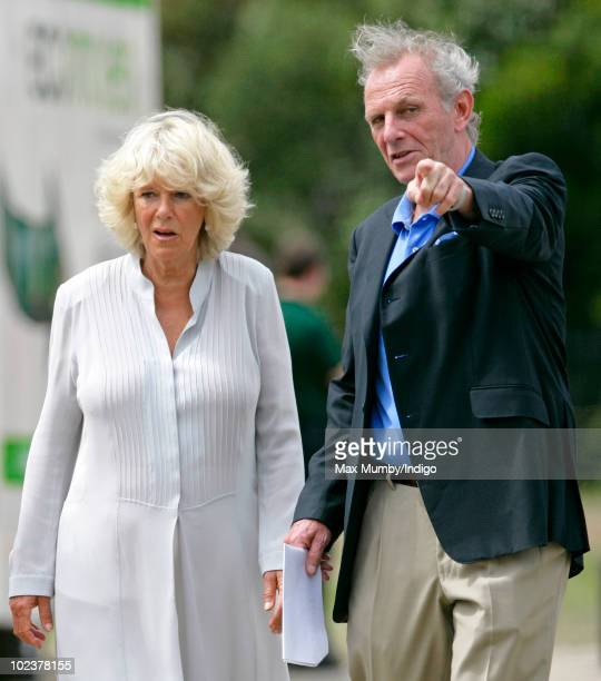 Camilla Duchess of Cornwall talks with her brother Mark Shand as he gives her a tour of the Elephant Parade at The Royal Hospital Chelsea on June 24...